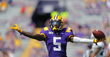 LSU cornerback Kary Vincent Jr. (5) celebrates his interception in the second half of an NCAA college football game against Utah State in Baton Rouge, La., Saturday, Oct. 5, 2019. LSU won 42-6.