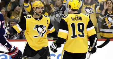 Pittsburgh Penguins' Kris Letang (58) celebrates his goal with Jared McCann during the second period of an NHL hockey game against the Columbus Blue Jackets in Pittsburgh, Saturday, Oct. 5, 2019.