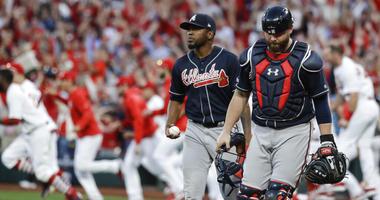 Atlanta Braves' Julio Teheran and catcher Brian McCann walk to the dugout