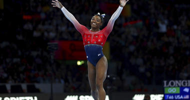 Simone Biles of the U.S. celebrates on the floor during women's team final at the Gymnastics World Championships in Stuttgart, Germany, Tuesday, Oct. 8, 2019.