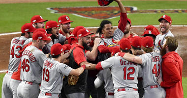 St. Louis Cardinals relief pitcher Genesis Cabrera waves his hat in the air as he celebrates with teammates after the Cardinals beat the Atlanta Braves 13-1 in Game 5 of their National League Division Series baseball game Wednesday, Oct. 9, 2019, in Atlan