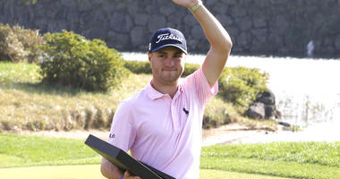 Justin Thomas of the United States waves with his trophy after winning the CJ Cup PGA golf tournament at Nine Bridges on Jeju Island, South Korea, Sunday, Oct. 20, 2019.