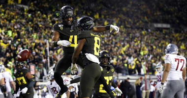 Oregon's Thomas Graham Jr., left, and Jevon Holland celebrate Holland's pick six against Washington State during the second quarter of an NCAA college football game Saturday, Oct. 26, 2019, in Eugene, Ore.