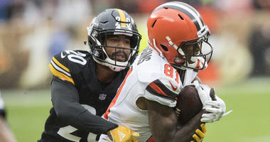 Pittsburgh Steelers cornerback Cameron Sutton (20) tackles Cleveland Browns wide receiver Rashard Higgins (81) after a catch during the second half at FirstEnergy Stadium.