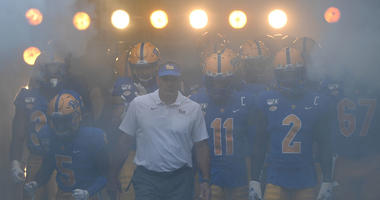 Head coach Pat Narduzzi of the Pittsburgh Panthers leads his team onto the field for a game