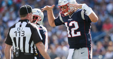 Tom Brady #12 of the New England Patriots argues with referee after a penalty call