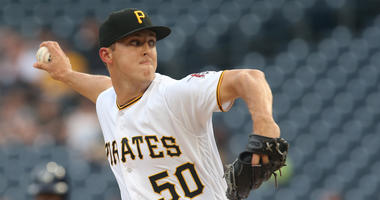 Pittsburgh Pirates starting pitcher Jameson Taillon (50) delivers a pitch against the Milwaukee Brewers during the first inning at PNC Park.