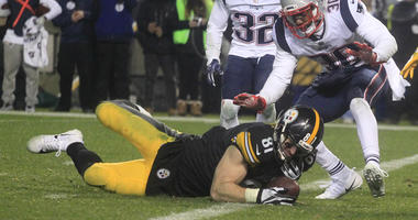 Pittsburgh Steelers tight end Jesse James (81) fails to hold the ball as he falls across the goal line against New England Patriots free safety Devin McCourty (32) and strong safety Duron Harmon (30)