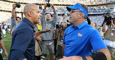 Penn State Nittany Lions head coach James Franklin (left) and Pittsburgh Panthers head coach Pat Narduzzi (right) congratulate each other at mid field following a game.