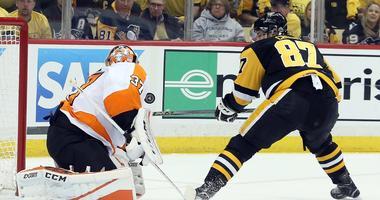 Brian Elliott stops Sidney Crosby on a breakaway.