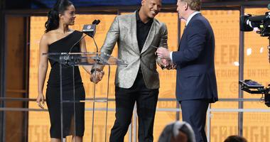 Pittsburgh Steelers linebacker Ryan Shazier walks across the stage with his fiancee Michelle Rodriguez