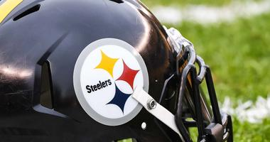 A Pittsburgh Steelers helmet sits on the field