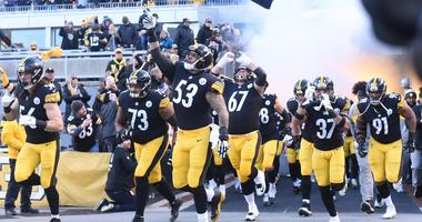 The Pittsburgh Steelers led by center Maurkice Pouncey (53) enter the field before playing the Cincinnati Bengals at Heinz Field