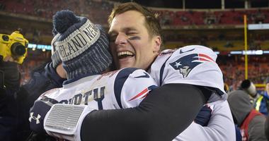 Tom Brady hugs Devin McCourty