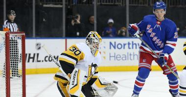 Pittsburgh Penguins goalie Matt Murray makes a save in front of New York Rangers left wing Jimmy Vesey