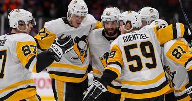 Pittsburgh Penguins defenseman Justin Schultz (4) celebrates his goal with the teammates