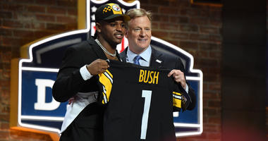 Devin Bush with Roger Goodell