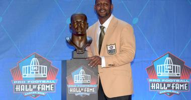 Ty Law poses with bust during the Pro Football Hall of Fame Enshrinement