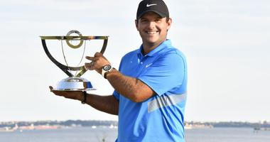 Patrick Reed poses with the winners trophy after winning The Northern Trust