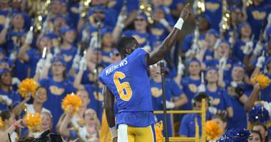 Pittsburgh Panthers wide receiver Aaron Mathews leads the PITT band in the alma mater