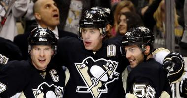 Pittsburgh Penguins center Sidney Crosby (87) and center Evgeni Malkin (71) and defenseman Kris Letang