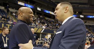 Florida State Seminoles head coach Leonard Hamilton (left) and Pittsburgh Panthers head coach Jeff Capel (right) shake hands before their teams play at the Petersen Events Center.