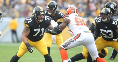 Pittsburgh Steelers offensive tackle Matt Feiler (71) blocks at the line of scrimmage against Cleveland Browns defensive end Emmanuel Ogbah (90) during the second quarter at Heinz Field.