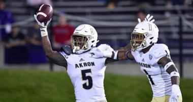 Akron Zips linebacker Ulysees Gilbert III (5) react after scoring a touchdown on a fumble recovery in the second half against the Northwestern Wildcats at Ryan Field.