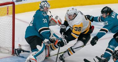 San Jose Sharks goaltender Martin Jones (31) makes a save against Pittsburgh Penguins center Derek Grant (38) during the third period the at SAP Center at San Jose.