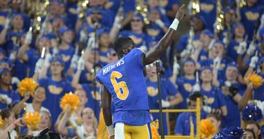 Pittsburgh Panthers wide receiver Aaron Mathews (6) leads the PITT band in the alma mater after defeating the UCF Knights at Heinz Field. Pittsburgh won 35-34.