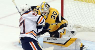 Pittsburgh Penguins goaltender Matt Murray (30) makes a save on a penalty shot by Edmonton Oilers center Connor McDavid (97) during the second period at PPG PAINTS Arena.