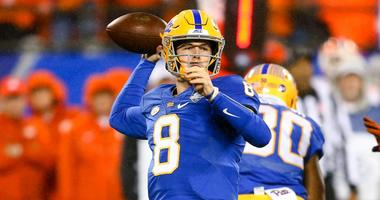 Pittsburgh Panthers quarterback Kenny Pickett (8) drops back to pass the ball in the first quarter against the Clemson Tigers in the ACC championship game at Bank of America Stadium.