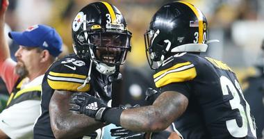 Pittsburgh Steelers running back Jaylen Samuels (38) congratulates running back James Conner (30) on his touchdown against the Cincinnati Bengals during the second quarter at Heinz Field.
