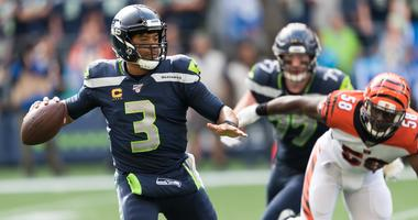 Seattle Seahawks quarterback Russell Wilson (3) scrambles during the second half against the Cincinnati Bengals at CenturyLink Field. Seattle defeated Cincinnati 21-20.