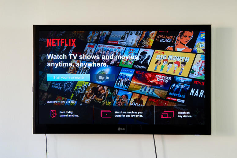 MONTREAL, CANADA - NOVEMBER 15, 2017: Netflix Sign In and free trial page on LG TV. Netflix is an American entertainment company founded by Reed Hastings and Marc Randolph on August 1997, in CA USA