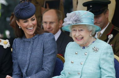 Catherine, Duchess of Cambridge and Queen Elizabeth II watch part of a children's sports event while visiting Vernon Park during a Diamond Jubilee visit to Nottingham on June 13, 2012 in Nottingham, England.
