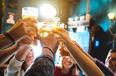 people drinking beer saying cheers