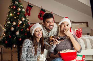 three people watching christmas movie