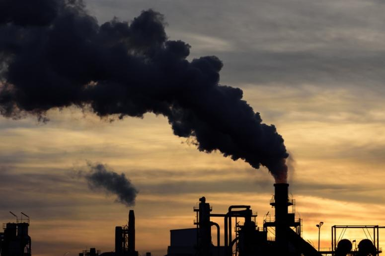 factories emitting pollution into atmosphere