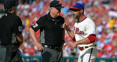 Gabe Kapler argues with umpires.