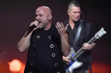 Singer David Draiman (L) and guitarist Dan Donegan of Disturbed perform at T-Mobile Arena on January 12, 2019 in Las Vegas, Nevada