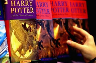 A woman looks at some of J.K Rowlings Harry Potter books in waterstones book store on June 16, 2003 in London.
