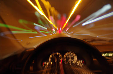 Blurred motion car drivers view traveling through tunnel - car motion blur night traffic fast dui driving under the influence