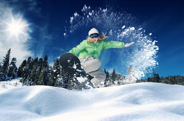 A young girl snowboarding in winter environment. (Photo  credit: Getty Images)