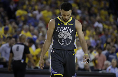 Golden State Warriors' Stephen Curry walks on the court during a timeout in the second quarter of Game 6 of basketball's NBA Finals against the Toronto Raptors Thursday, June 13, 2019, in Oakland, Calif. (AP Photo/Ben Margot)