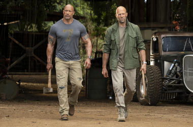 """This image released by Universal Pictures shows Dwayne Johnson, left, and Jason Statham in a scene from """"Fast & Furious Presents: Hobbs & Shaw."""" (Photo credit: Frank Masi/Universal Pictures via AP)"""