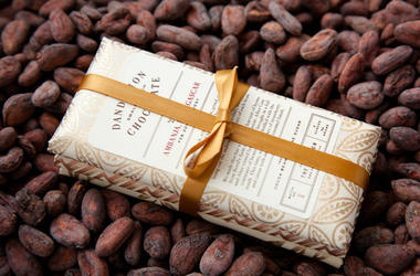 3-pack of Dandelion Chocolate on top of cocoa beans (Photo credit: Molly DeCoudreaux/Dandelion Chocolate)
