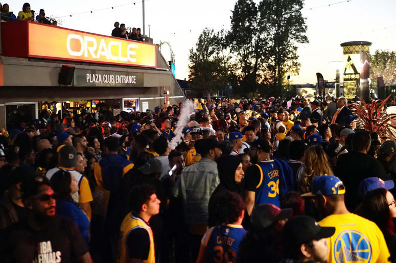 Jun 8, 2018; Oakland, CA, USA; Golden State Warriors fans celebrate in the plaza between Oracle Arena and Oakland Coliseum after the win against the Cleveland Cavaliers in game four of the 2018 NBA Finals. Mandatory Credit: Kelley L Cox-USA TODAY Sports