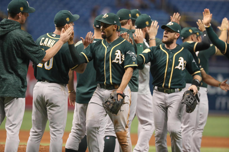Sep 14, 2018; St. Petersburg, FL, USA; Oakland Athletics shortstop Marcus Semien (10) and Oakland Athletics second baseman Jed Lowrie (8) congratulate each other as they beat the Tampa Bay Rays at Tropicana Field. Mandatory Credit: Kim Klement-USA TODAY S
