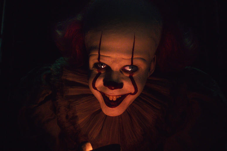 """This image released by Warner Bros. Pictures shows Bill Skarsgard as Pennywise in New Line Cinema's horror thriller """"It: Chapter 2."""" (Warner Bros. Pictures via AP)"""